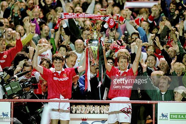 Steve Bruce and Bryan Robson of Manchester United celebrate with the premiership trophy after clinching the title during the FA Carling Premiership...