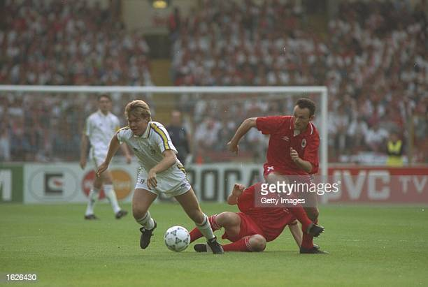 Tomas Brolin of Parma and Rudy Taeymans of Antwerp in action during the European Cup Winners Cup final at Wembley Stadium in London Parma won the...
