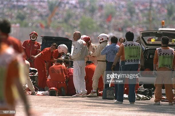 The Medical team surrounds Williams Renault driver Ayrton Senna of Brazil after Senna crashes during the San Marino Grand Prix at the Imola circuit...