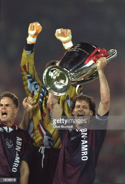 Danny Blind of Ajax raises the trophy in celebration after their victory in the European Cup Final against Milan in Vienna Austria Ajax won the match...