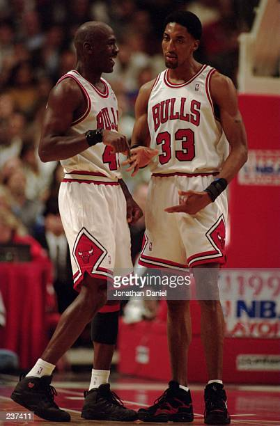 Guard Michael Jordan of the Chicago Bulls celebrates with foward Scottie Pippen during the Bulls 10380 win over the Charolette Hornets in the first...