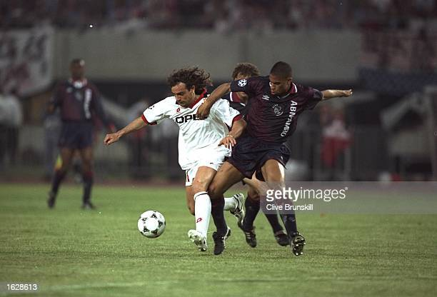 Marco Simone of AC Milan is tackled by Winston Bogarde of Ajax during the European Cup Final in Vienna Austria Ajax won the match 10 Mandatory Credit...