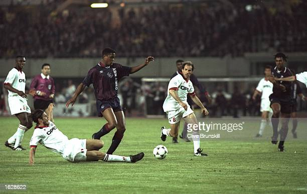 Patrick Kluivert of Ajax robs Franco Baresi of AC Milan of the ball during the European Cup Final in Vienna Austria Ajax won the match 10 Mandatory...