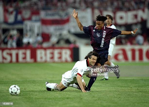 Roberto Donadoni of AC Milan is bundled over by Edgar Davids of Ajax during the European Cup Final in Vienna Austria Mandatory Credit Clive Brunskill...