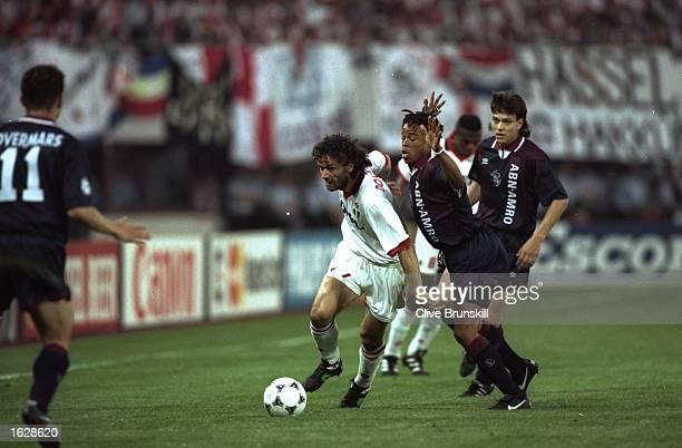 Roberto Donadoni of AC Milan keeps the ball away from Edgar Davids and Jari Litmanen of Ajax during the European Cup Final in Vienna Austria Ajax won...