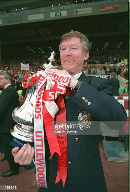 Alex Ferguson with the trophy after Man Utd's victory over Liverpool in the 1996 FA Cup Final between Manchester United v Liverpool at Wembley...