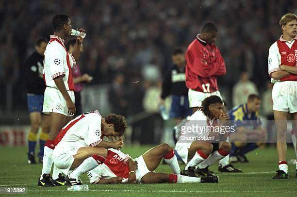 Despairing Ajax Amsterdam players watch the penalty shoot out in the European Cup Final against Juventus in Rome Italy Juventus won the penalty shoot...