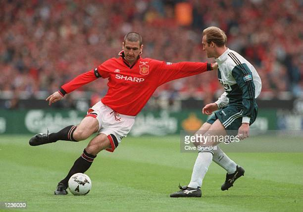 Eric Cantona of Man Utd goes past John Scales of Liverpool during the 1996 FA Cup Final between Manchester United v Liverpool at Wembley Stadium...