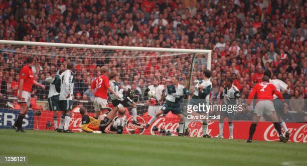 Eric Cantona scores the wining goal to give Manchester United victory over Liverpool in the 1996 FA Cup Final between Manchester United v Liverpool...