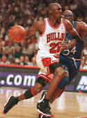 Guard Michael Jordan of the Chicago Bulls drives around forward Horace Grant of the Orlando Magic during the third quarter of game one of the Eastern...