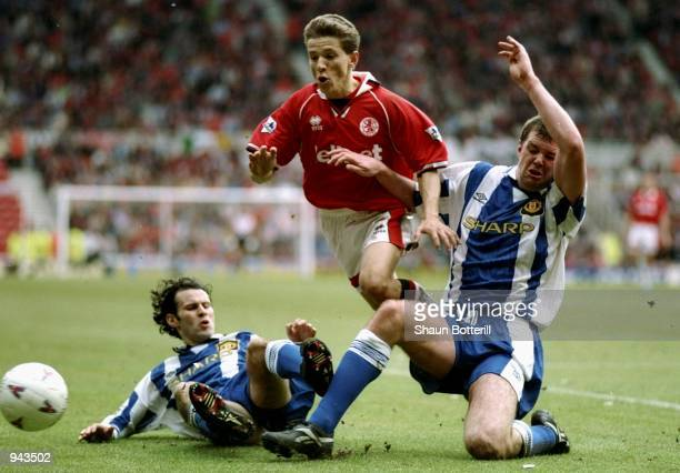 Juninho of Middlesbrough goes between Ryan Giggs and Gary Pallister of Manchester United during the FA Carling Premiership match at the Riverside...