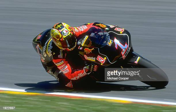 Massimiliano Biaggi of Italy leans into a corner on his Aprilia during the Italiian Grand Prix at the Mugello circuit in Italy Biaggi finished in...