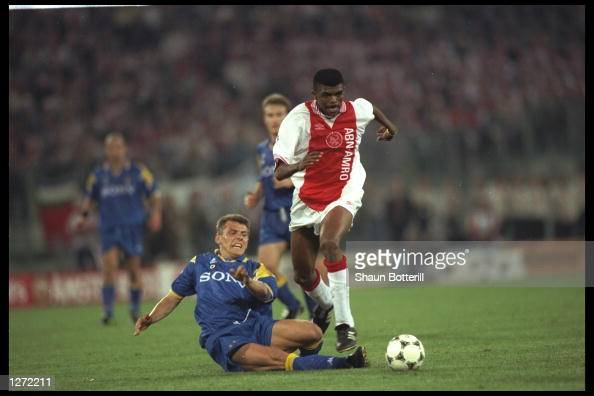 Nwankwo Kanu of Ajax is challenged by Dider Deschkrips of Juventus during the European Cup Final in Amsterdam Netherlands The game went to penaltys...