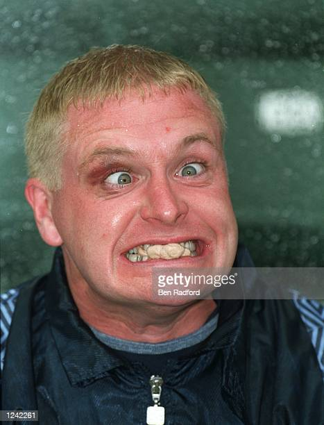 Paul Gascoigne of Great Britain pulls a face as he sits on the subs bench during the Hong Kong XI v England match played in Hong Kong England won 10...