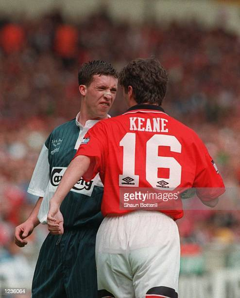 Roy Keane of Man Utd confronts Robbie Fowler of Liverpool during the 1996 FA Cup Final between Manchester United v Liverpool at Wembley Stadium...