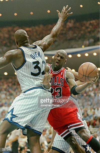 Shaquille O''Neal of the Orlando Magic tries to stop a shot by Michael Jordan of the Chicago Bulls during the first half of Game 4 of the Eastern...