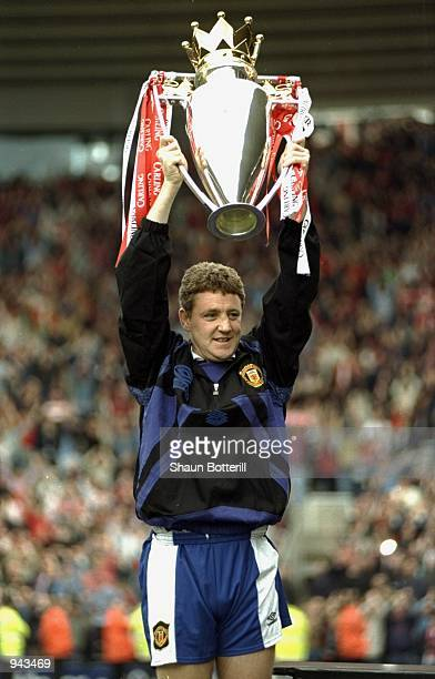 Steve Bruce of Manchester United lifts the FA Carling Premiership trophy after the match against Middlesbrough at the Riverside Stadium in...