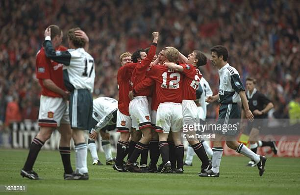 The Manchester United players celebrate as the final whistle blows after winning the F A Cup Final match against Liverpool at Wembley Stadium in...