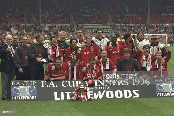 The Manchester United team pose for a photograph after they win the F A Cup against Liverpool at Wembley Stadium in London Manchester United won the...