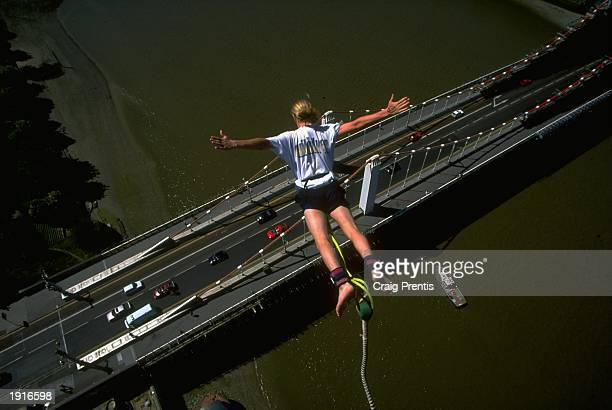 A bungee jumper plummets towards the ground during a jump at Chelsea Bridge in London England Mandatory Credit Craig Prentis /Allsport