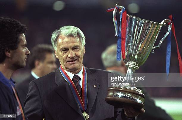Bobby Robson the Barcelona manager holds aloft the European Cup Winners Cup after victory against Paris St Germain in Rotterdam Holland Barcelona won...