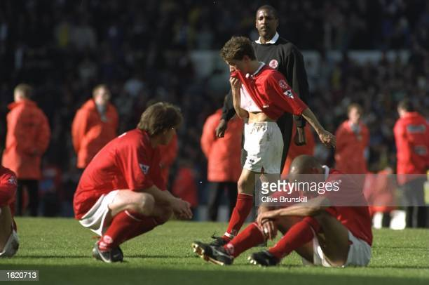 Craig Hignett Juninho and Curtis Fleming of Middlesbrough face relegation after the FA Carling Premier League match against Leeds United at Elland...