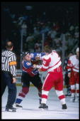 Defenseman Adam Foote of the Colorado Avalanche fights with defenseman Vladimir Konstantinov of the Detroit Red Wings during a playoff game at Joe...