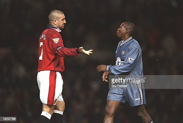 Eric Cantona of Manchester United and Faustino Asprilla of Newcastle United face to face during the FA Carling Premier League match at Old Trafford...