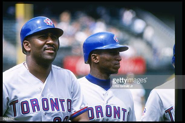 First basemen Joe Carter and outfielder Jacob Brumfield of the Toronto Blue Jays stand on the field during a game against the Oakland Athletics at...