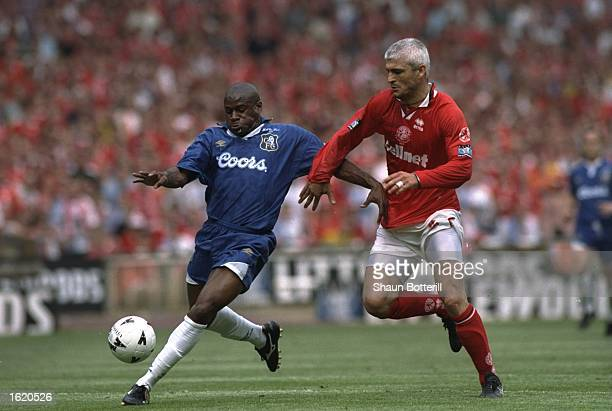 Frank Sinclair of Chelsea holds off Fabrizio Ravanelli of Middlesbrough during the FA Cup Final at Wembley Stadium in London England Chelsea won 20...