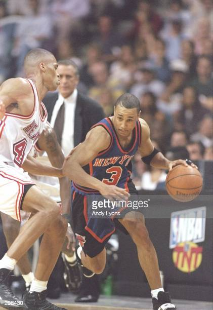 Guard John Starks of the New York Knicks tries to fend off forward PJ Brown of the Miami Heat during a playoff game at the Miami Arena in Miami...