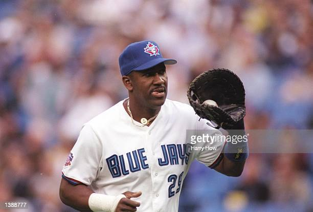Infielder Joe Carter of the Toronto Blue Jays looks on during a game against the New York Yankees at the Skydome in Toronto Ontario The Yankees won...
