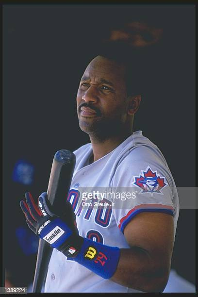 Infielder Joe Carter of the Toronto Blue Jays looks on during a game against the Oakland Athletics at the OaklandAlameda County Coliseum in Oakland...