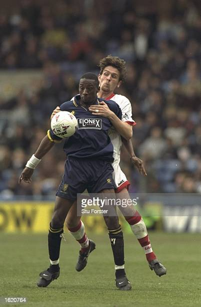 Jason Ewell of Wimbledon shields the ball from Richard Ord of Sunderland during the FA Carling Premier League match at Selhurst Park in London...