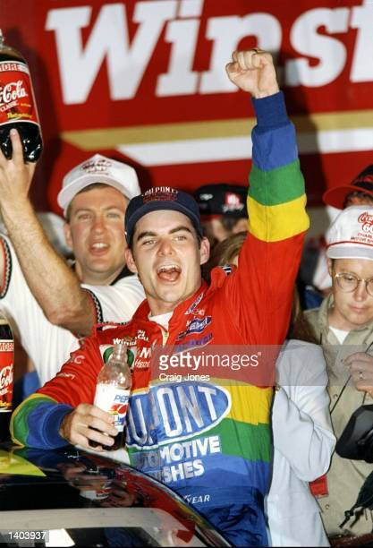Jeff Gordon cheers with the crowd as he wins the CocaCola 600 at the Charlotte Motor Speedway in Concord North Carolina