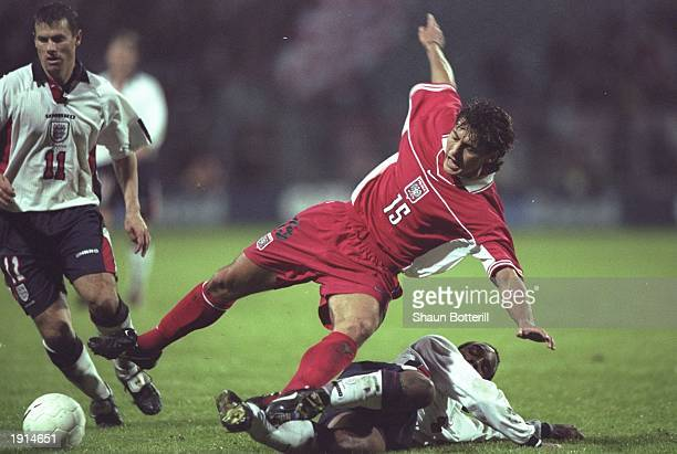Paul Ince of England slides in to make a tackle during the World Cup Qualifier against Poland at Chorzow Stadium in Katowice Poland England won 20...