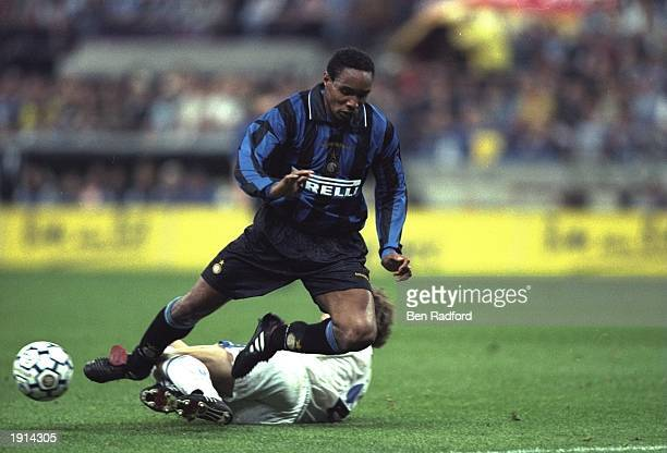 Paul Ince of Inter Milan is tackled by Thomas Linke of Schalke 04 during the UEFA Cup Final second leg at the San Siro in Milan Italy The match was...