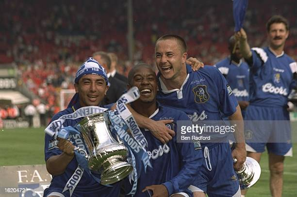 Roberto Di Matteo Eddie Newton and Dennis Wise of Chelsea celebrate victory in the FA Cup Final against Middlesbrough at Wembley Stadium in London...