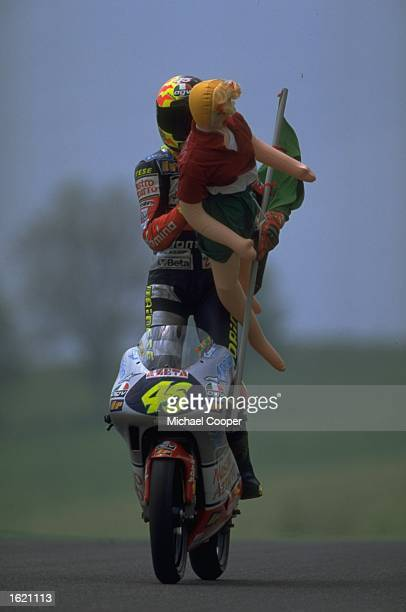Valentino Rossi of Italy celebrates with an unlikely companion after the Italian Motorcycle Grand Prix at Mugello in Italy Mandatory Credit Mike...
