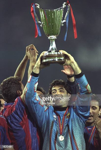 Vitor Baia the Barcelona goalkeeper holds aloft the European Cup Winners Cup after victory against Paris St Germain in Rotterdam Holland Barcelona...