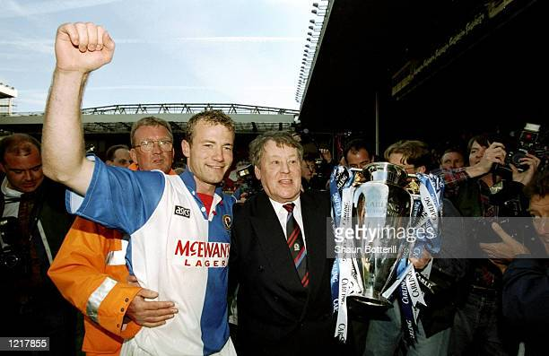 Alan Shearer and Jack Walker the owner of Blackburn Rovers celebrate with the trophy after winning the Premiership title during the FA Carling...