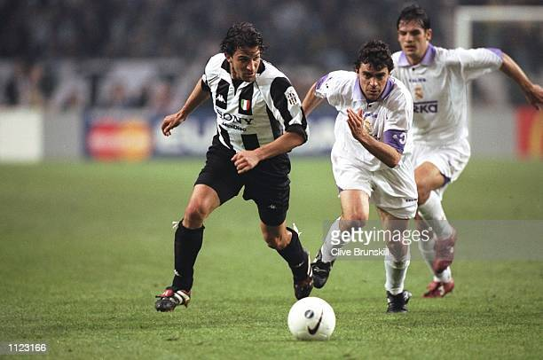 Alessandro del Piero of Juventus shadows Manuel Sanchis of Real Madrid during the Champions League final at the Amsterdam Arena in Holland Real...