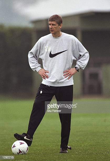 Arsenal Manager Arsene Wenger stands with his hands on his hips during a training session Mandatory Credit Stu Forster/Allsport