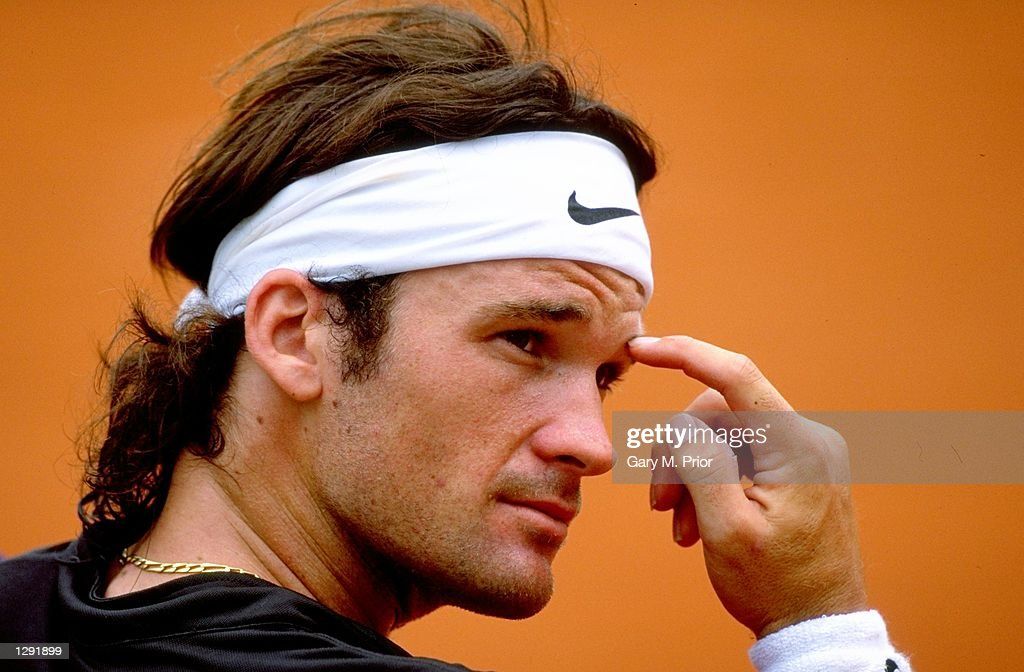 Carlos Moya of Spain takes a breather in the break between games during the 1998 French Open held at Roland Garros, Paris, France. \ Mandatory Credit: Gary M Prior/Allsport