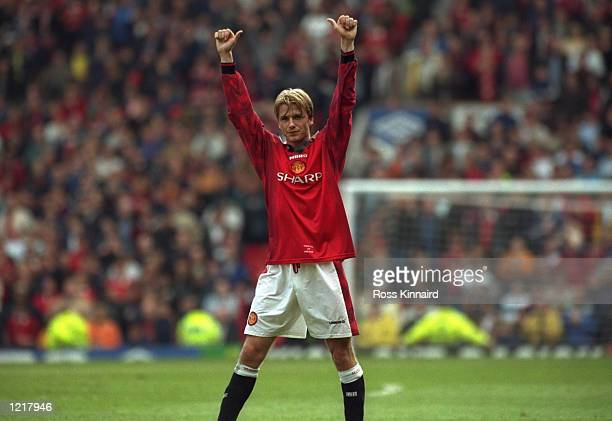 David Beckham of Manchester United celebrates after scoring a goal during the FA Carling Premiership match against Leeds United played at Old...
