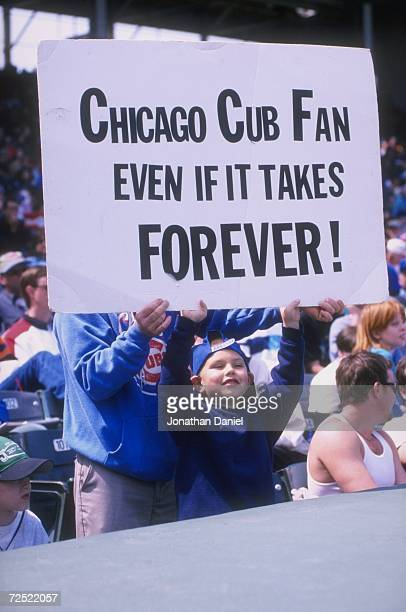 General view of fans holding a banner during a game between the San Francisco Giants and the Chicago Cubs at Wrigley Field in Chicago Illinois The...
