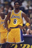 Kobe Bryant of the Los Angeles Lakers stands on court during the NBA Western Conference Finals against the Utah Jazz at the Great Western Forum in...