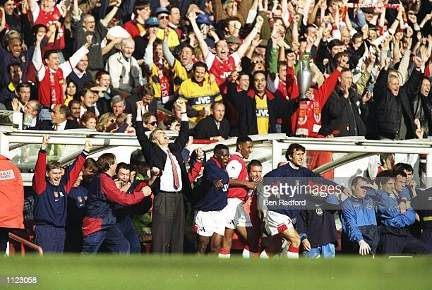 Manager Arsene Wenger and the Arsenal bench celebrate winning the championship after the FA Carling Premiership match against Everton at Highbury in...