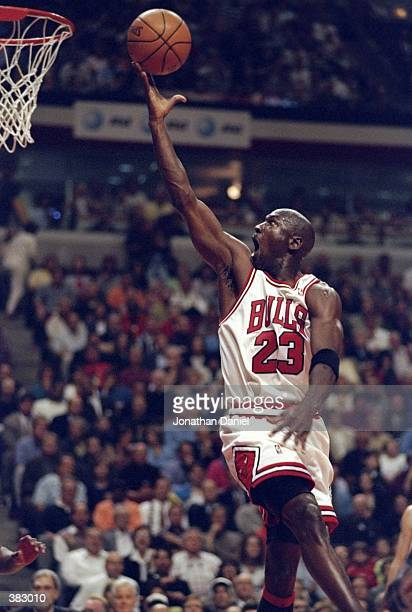 Michael Jordan of the Chicago Bulls shoots during the NBA Eastern Conference Finals at the United Center in Chicago Illinois The Bulls defeated the...