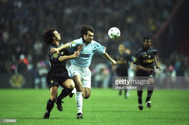 Pier Luigi Casiraghi of Lazio holds off Francesco Colonnese of Inter Milan during the UEFA Cup final at Parc des Princes in Paris Inter Milan won the...